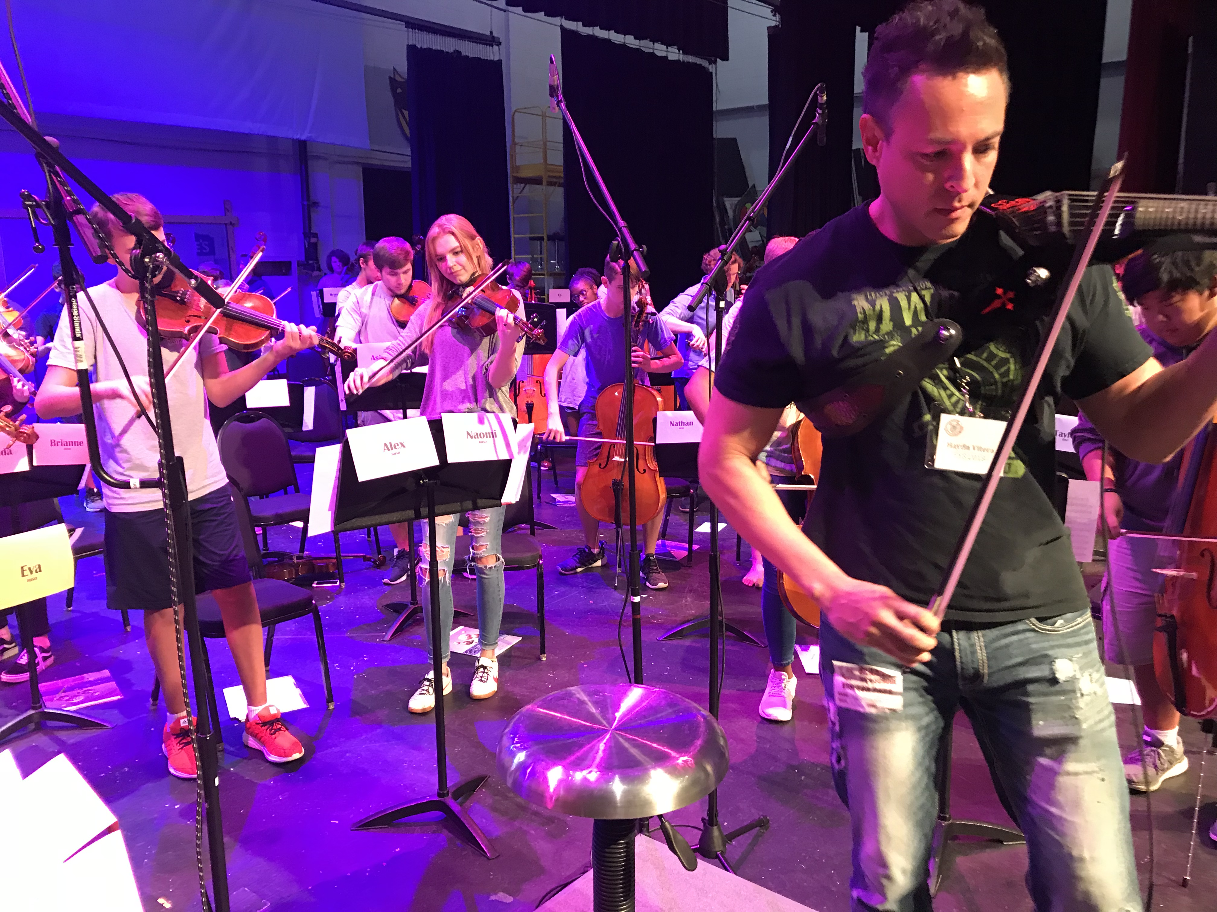Haydn Vitera, right, leads students during a rehearsal for the