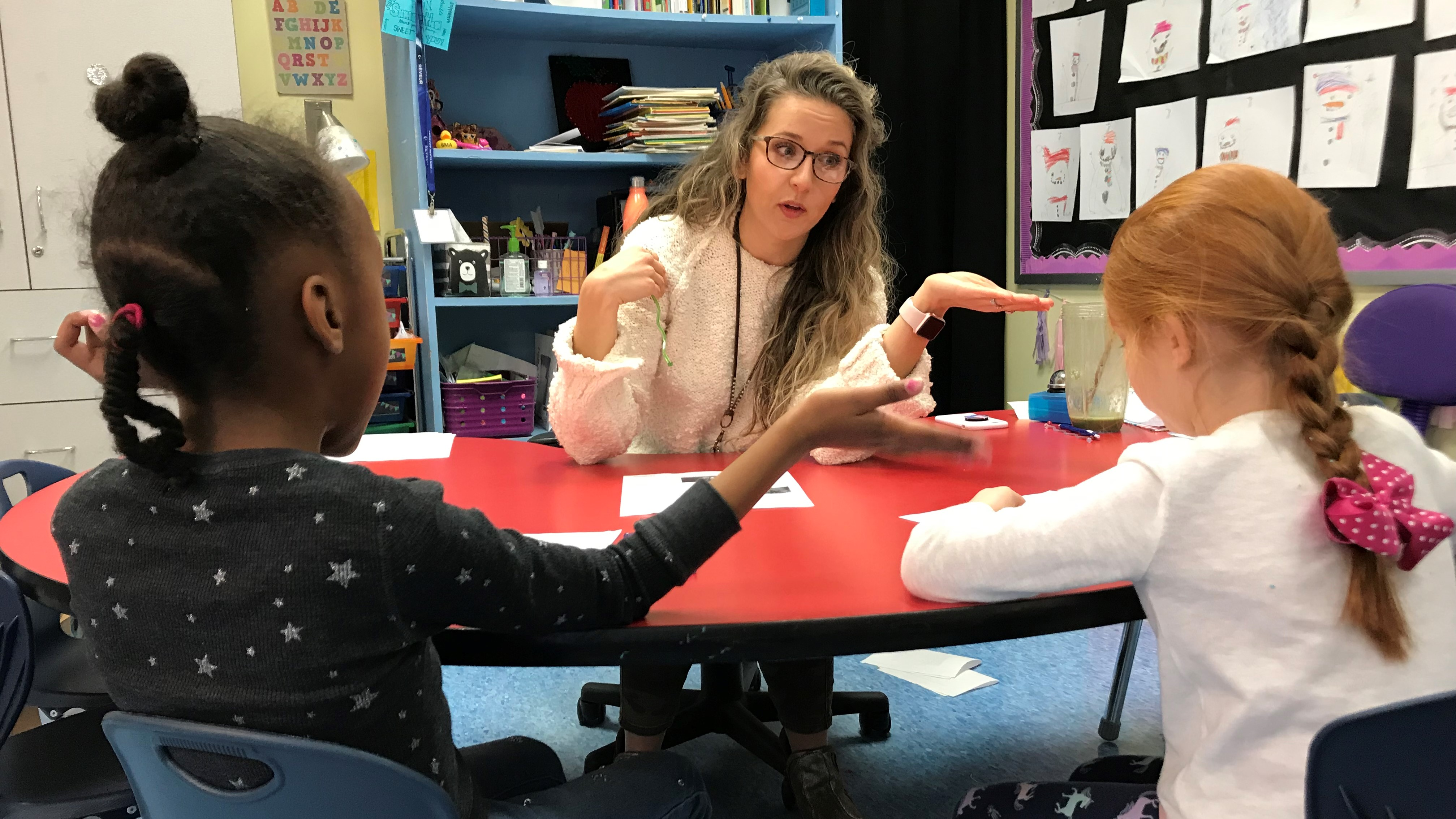 Samantha Wise, a kindergarten teacher at Beaumont Magnet Academy, works with students on Jan. 31, 2019.