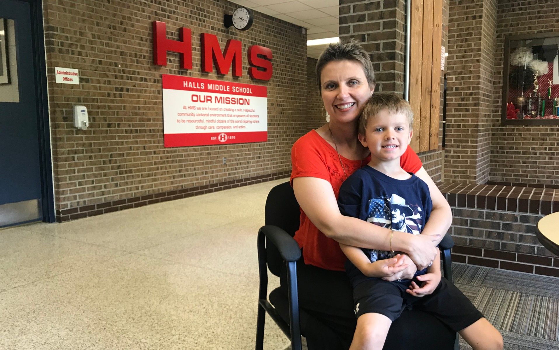 Karen Casteel, a music teacher at Halls Middle School, sits in the lobby with her son, Ethan.
