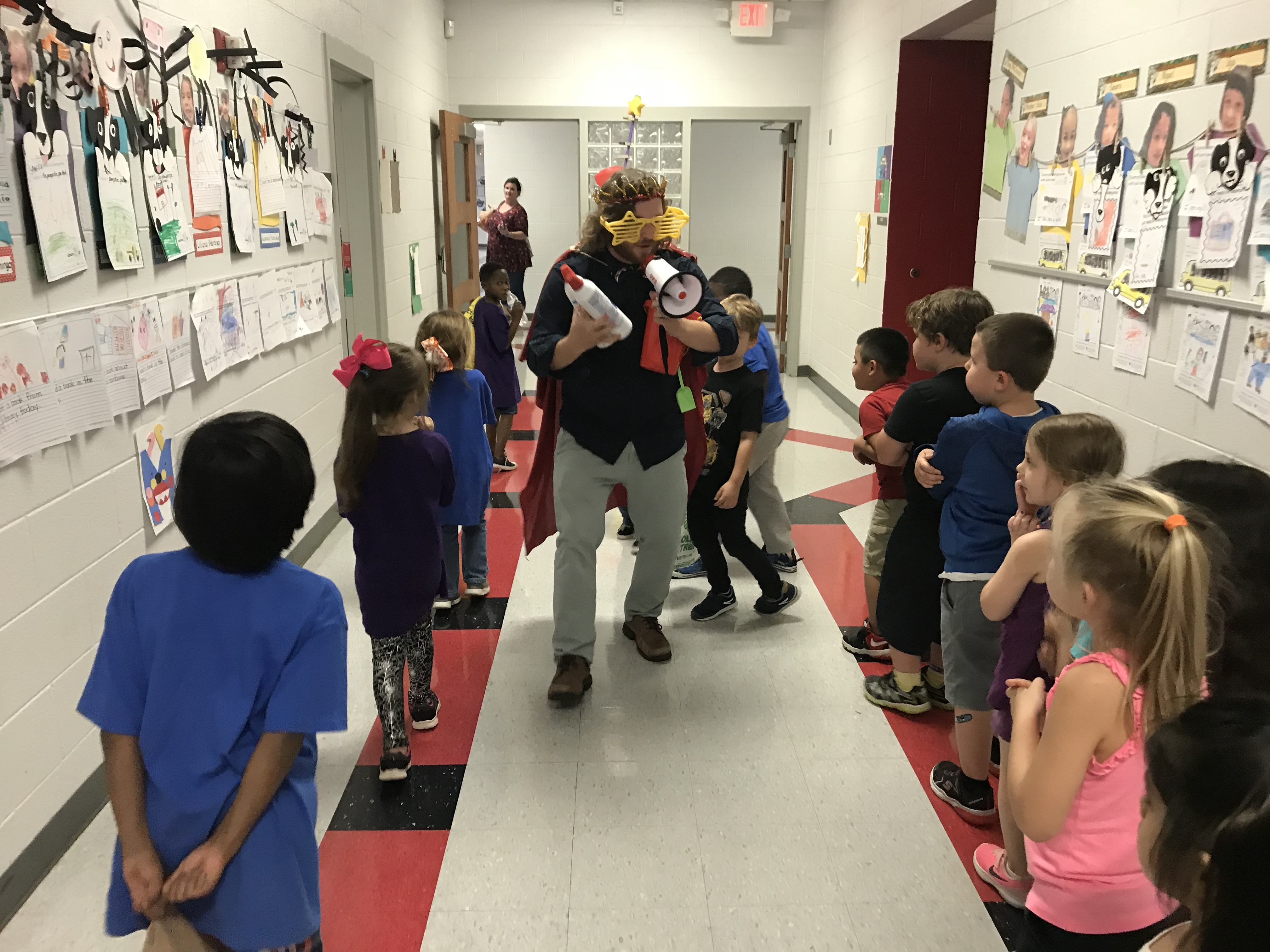 In character as the school's 'Dean of Fun,' Christenberry Elementary teacher Michael 'Mac' Comer invites students to a coupon celebration.