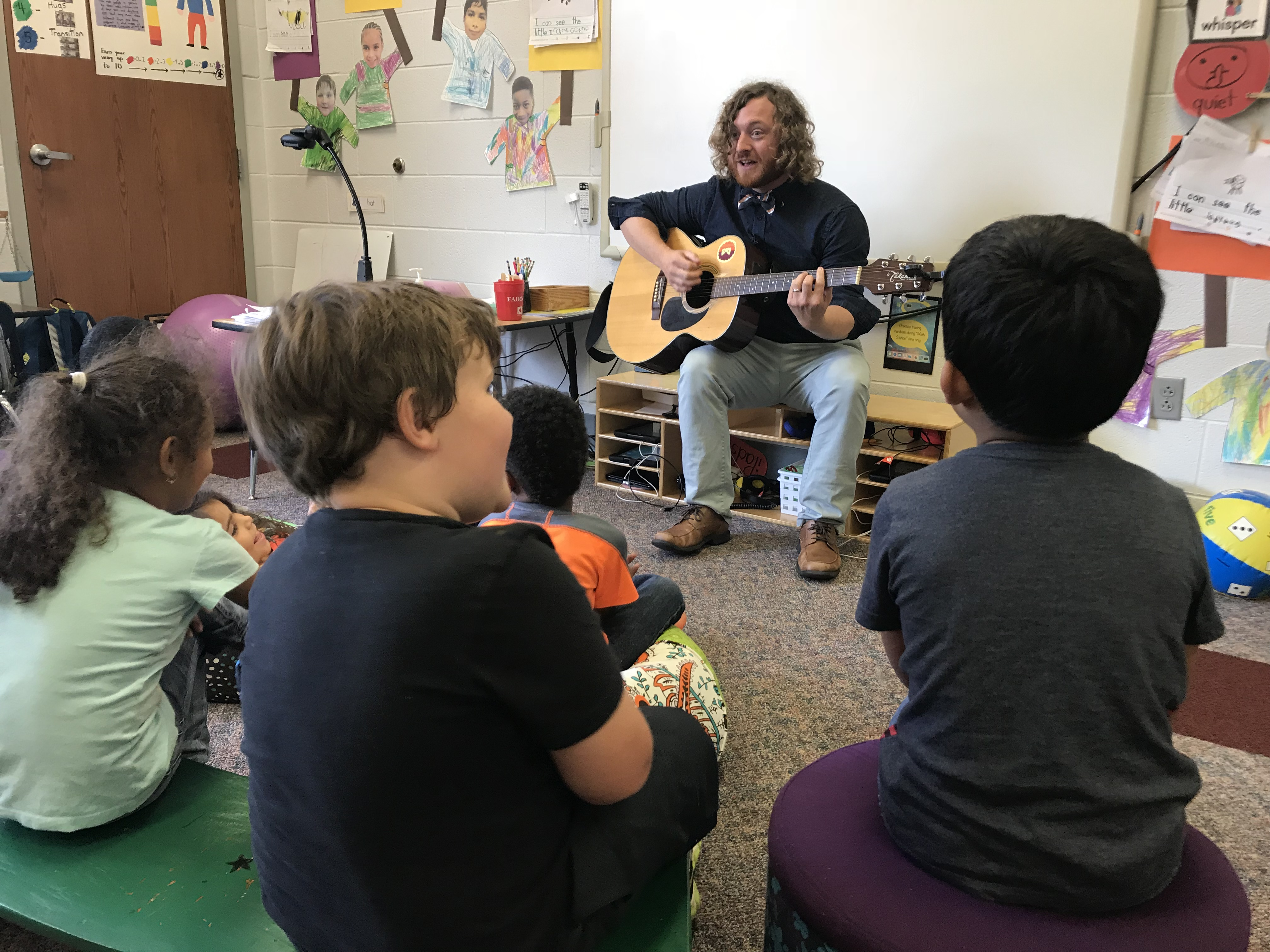 Christenberry Elementary teacher Michael 'Mac' Comer plays the guitar for his kindergarten class on Oct. 4, 2018