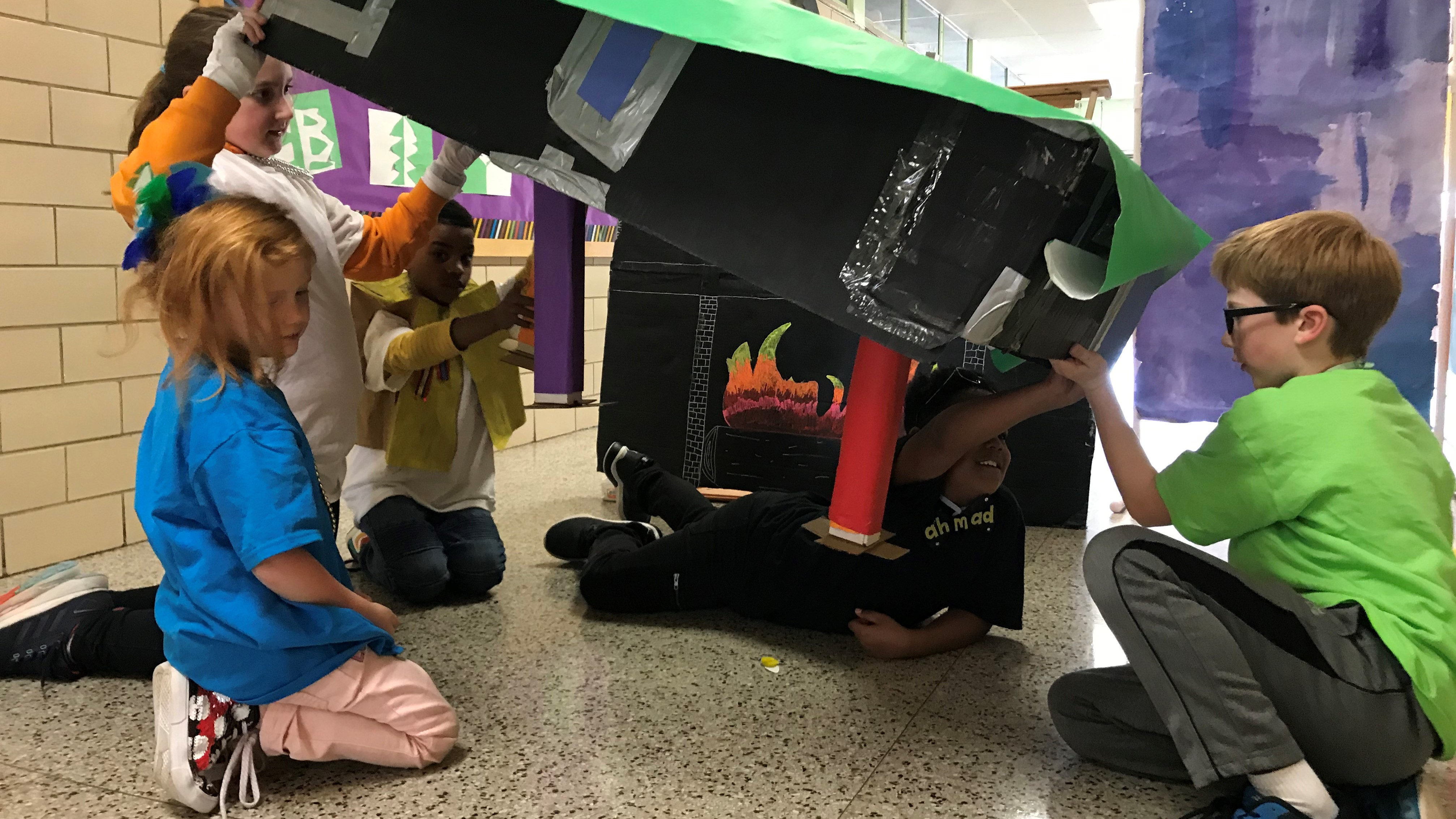 Green Magnet Academy students Birdie Lane (foreground) and (L-R) Sloan Frix, John Whittington, Ahmad Mack and Dansten Nichols, work on their Destination Imagination project, based on the board game