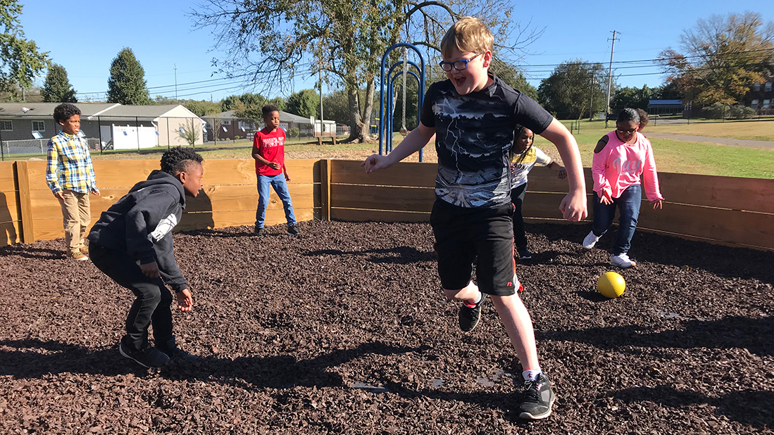 Fourth-grader Kory Ball tries to avoid getting hit during a game of gaga ball on Oct. 24, 2018.