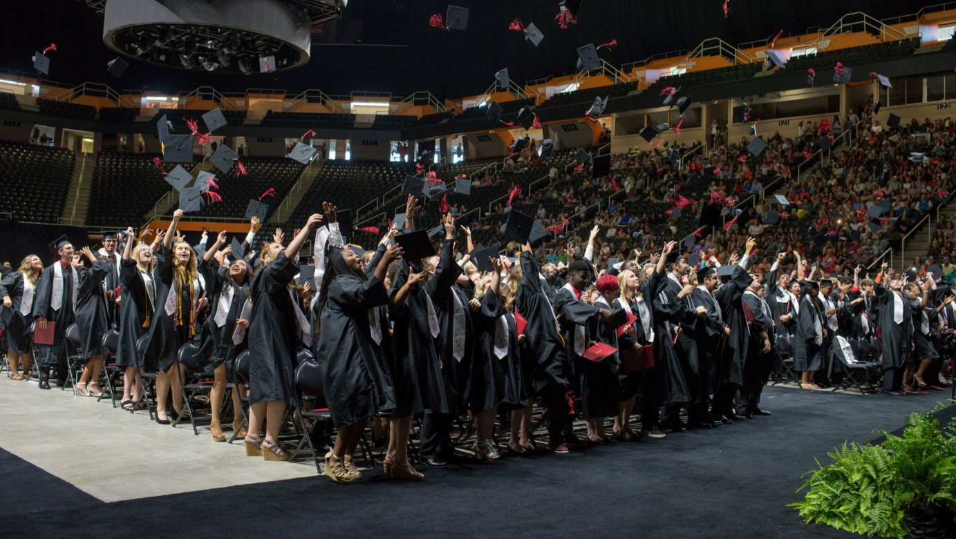Students celebrate graduation at Thompson-Boling Arena.