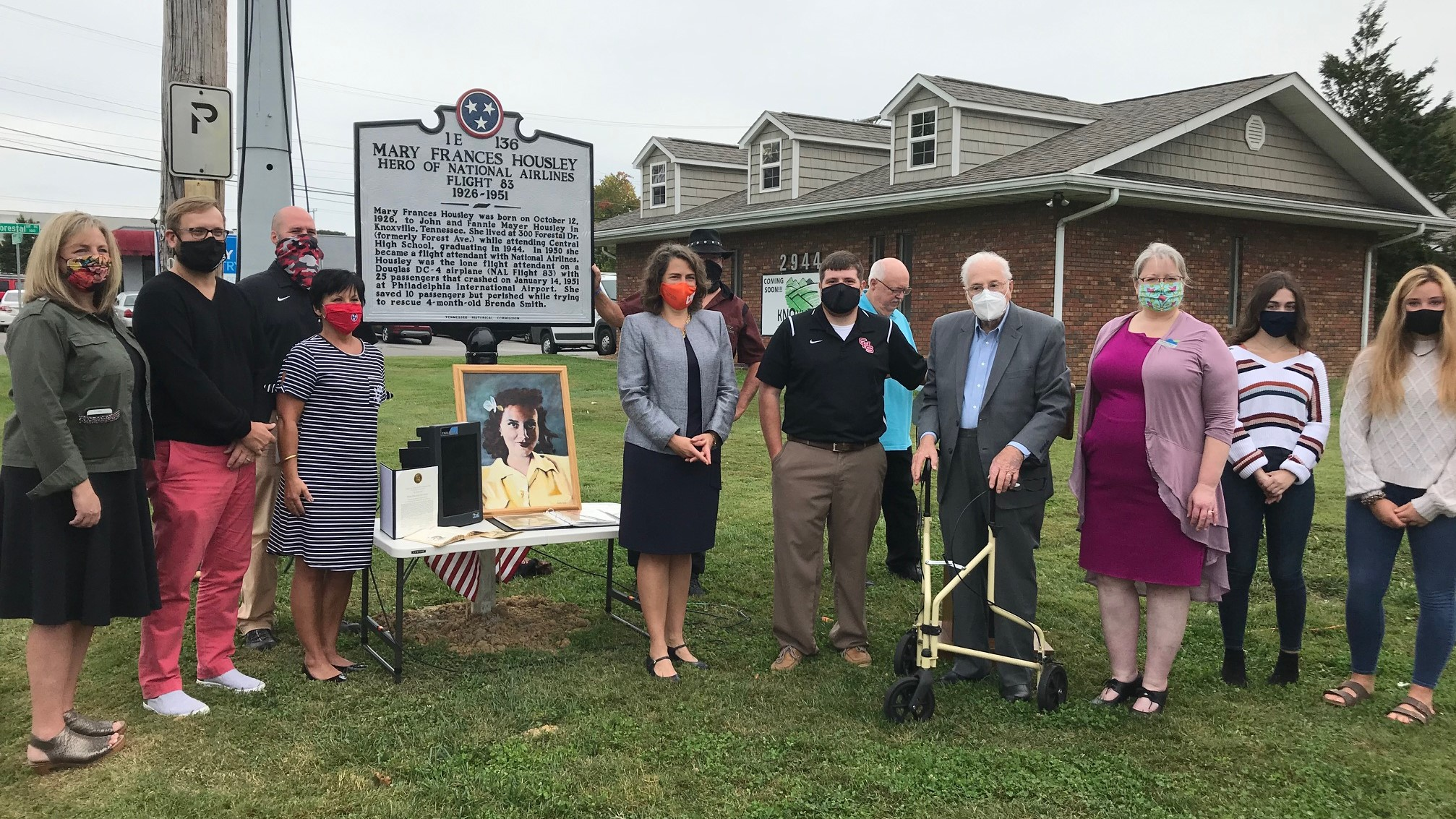 Community leaders gathered on Oct. 9 to remember Mary Frances Housley, a Central High School graduate who died in 1951, while trying ot rescue passengers from a plane crash.
