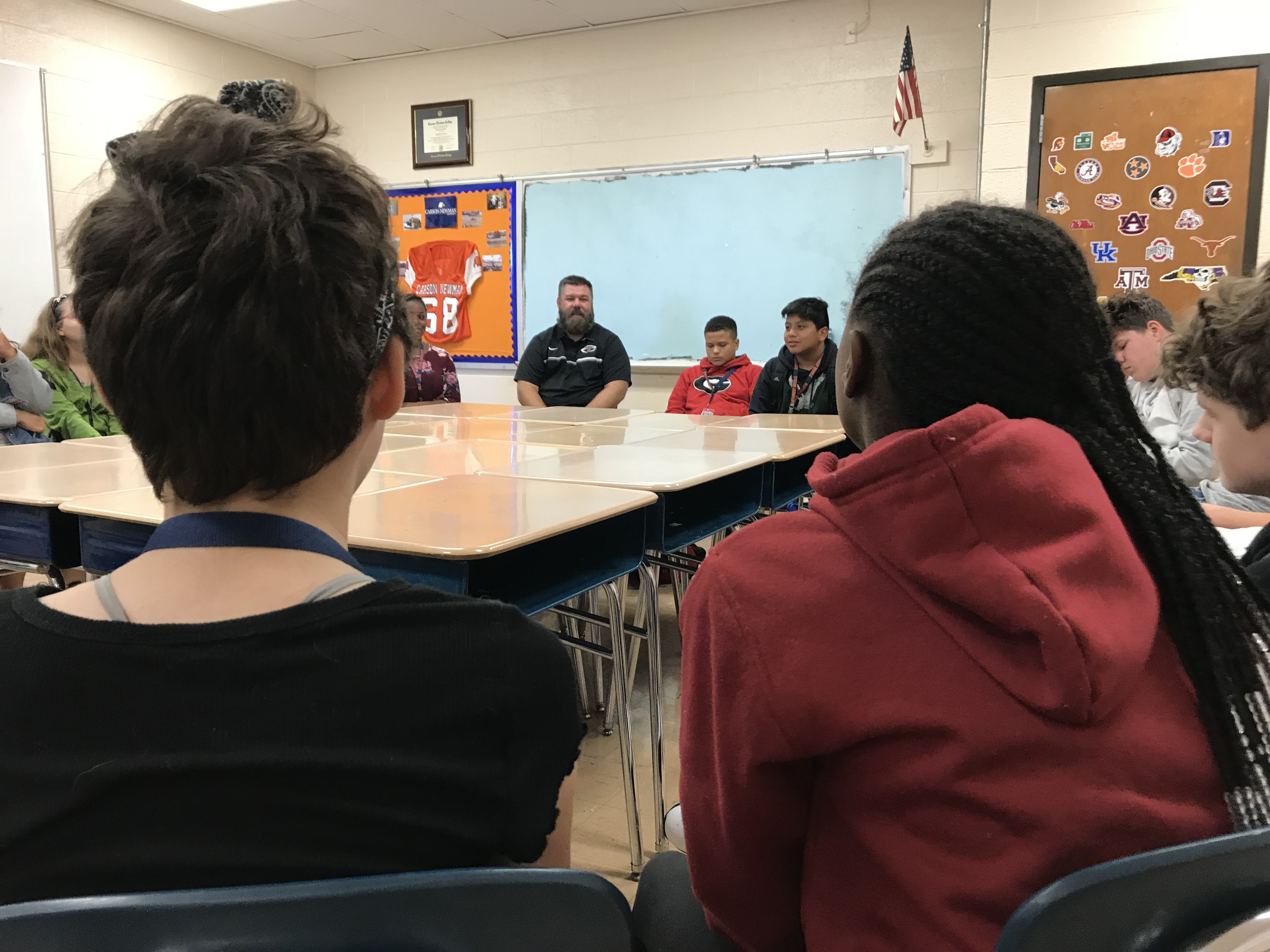 Northwest Middle School teacher Jason West leads a conversation circle on Oct. 19, 2018.