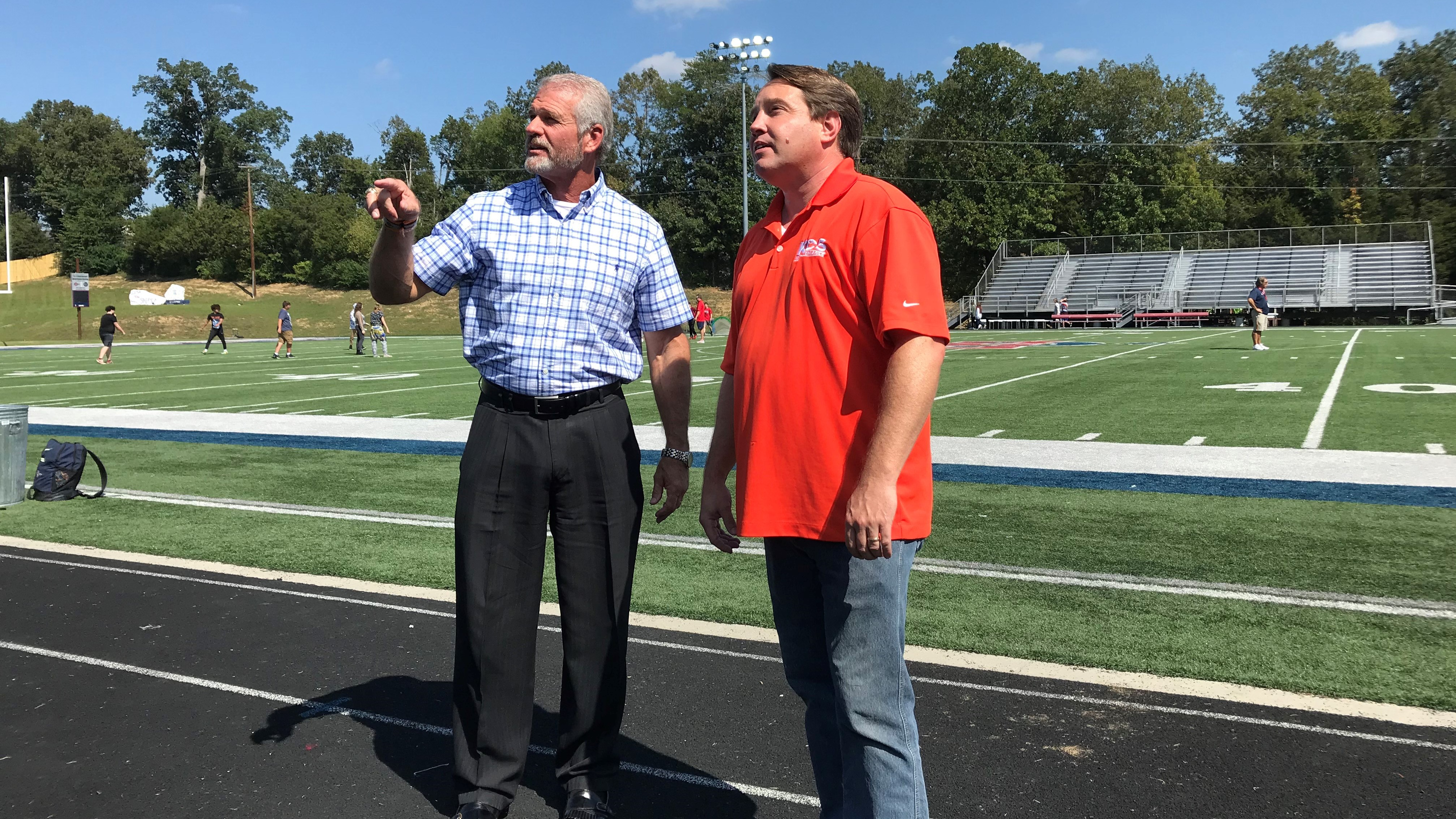 South-Doyle high school athletic director and football coach Clark Duncan (left) and KCS energy manager Zane Foraker discuss new LED lights that were recently installed at South-Doyle and other stadiums across Knox County.