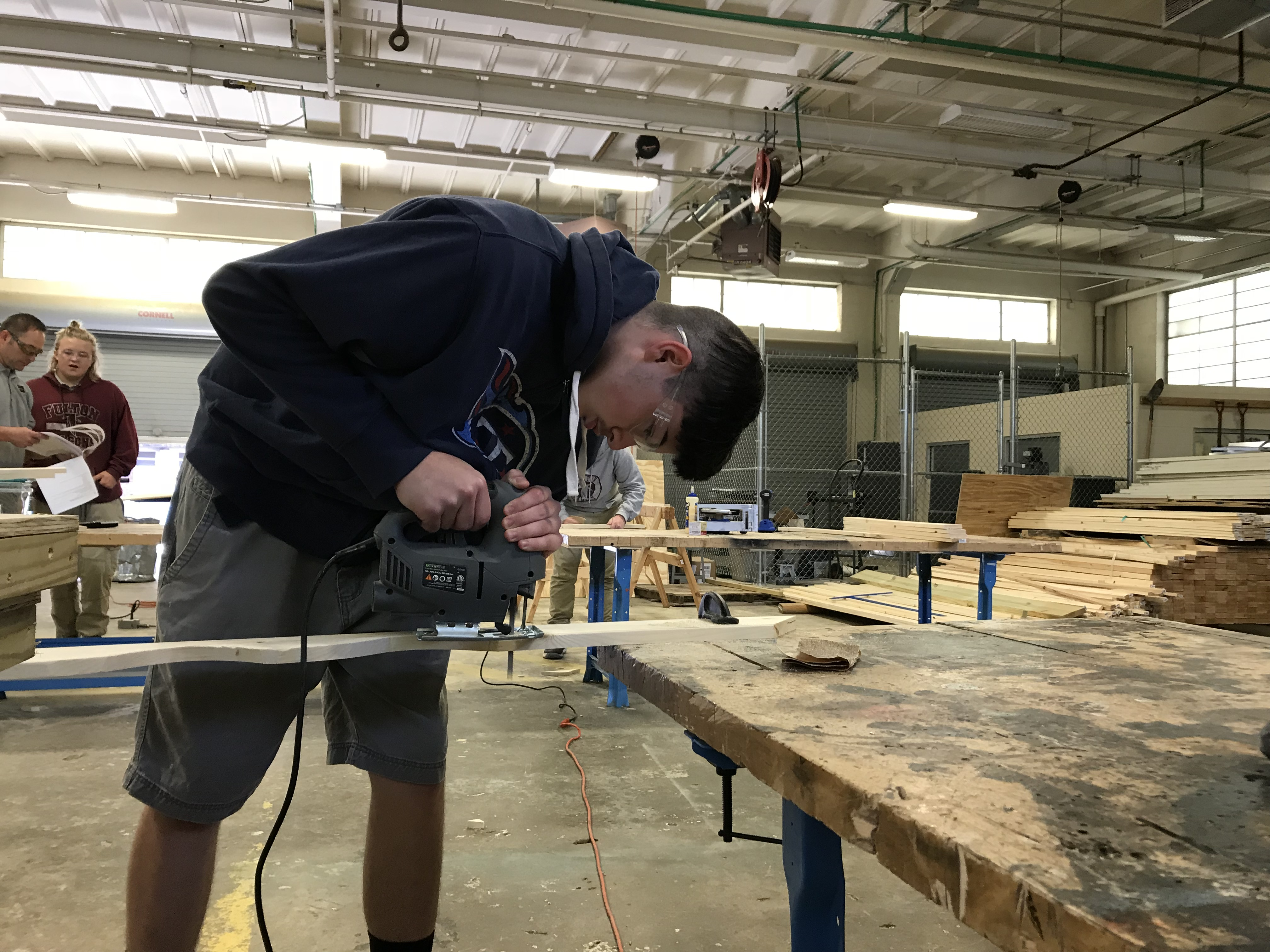 Fulton High School senior Matthew Maitland works on a fascia board for a playhouse sponsored by Habitat For Humanity.