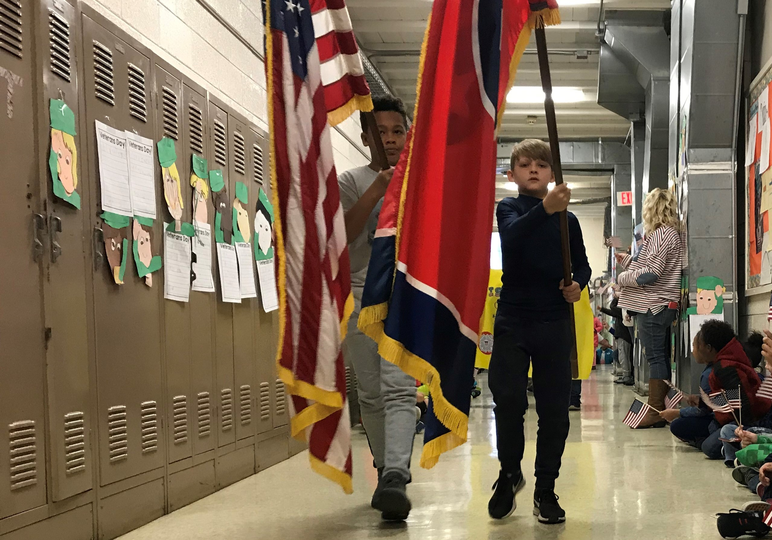Detrick Grove and Peyton Brookshire, 5th-graders at Pleasant Ridge Elementary School, lead a Veterans Day parade on Nov. 12, 2018.