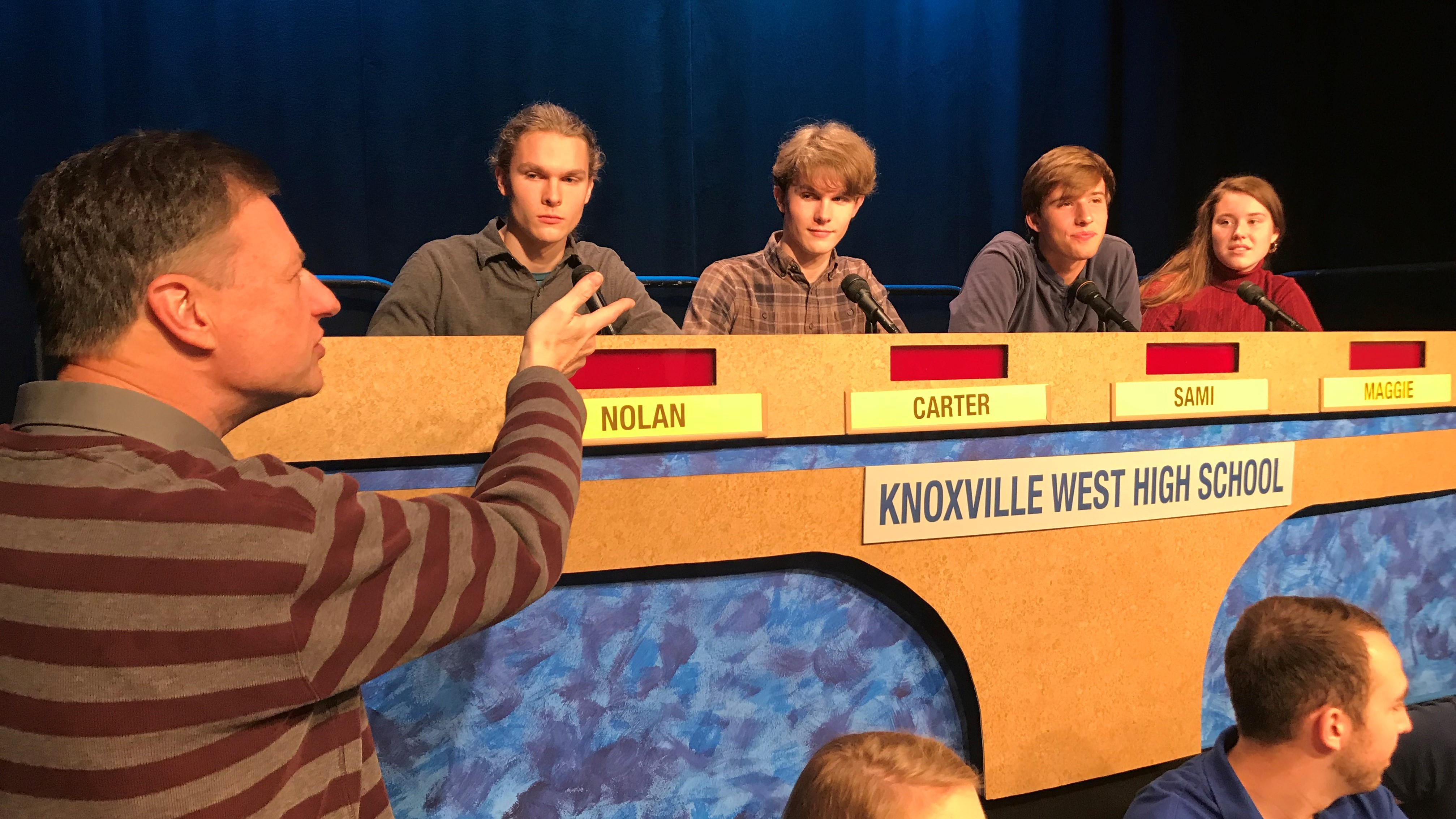 West High School students listen as Scholars Bowl executive producer Ernie Roberts gives instructions before a taping of the show.