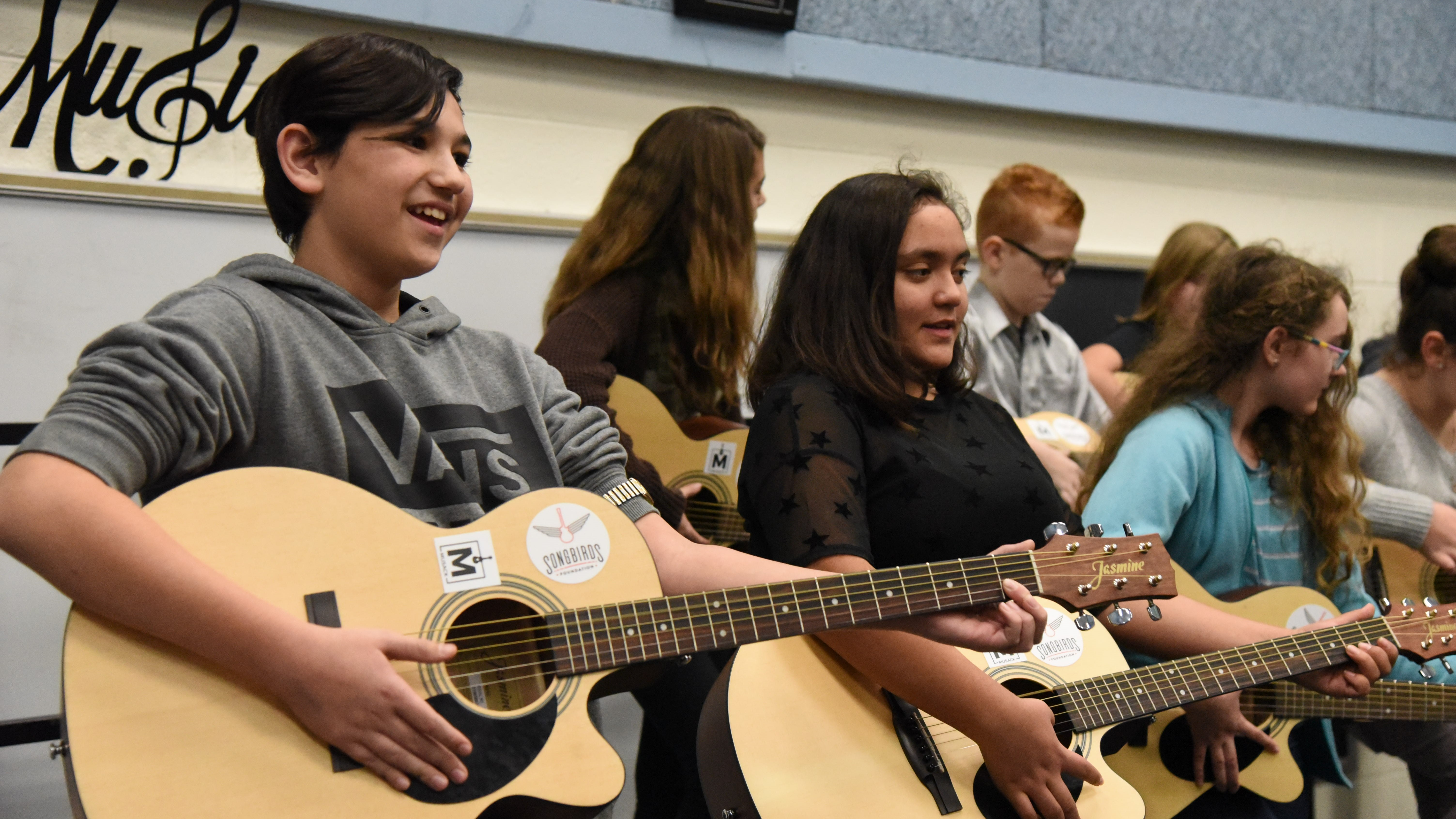In September, the Songbirds Foundation provided 25 new guitars to Karns Middle School. Students from the school will perform at a benefit concert with Chris Blue on Dec. 19.