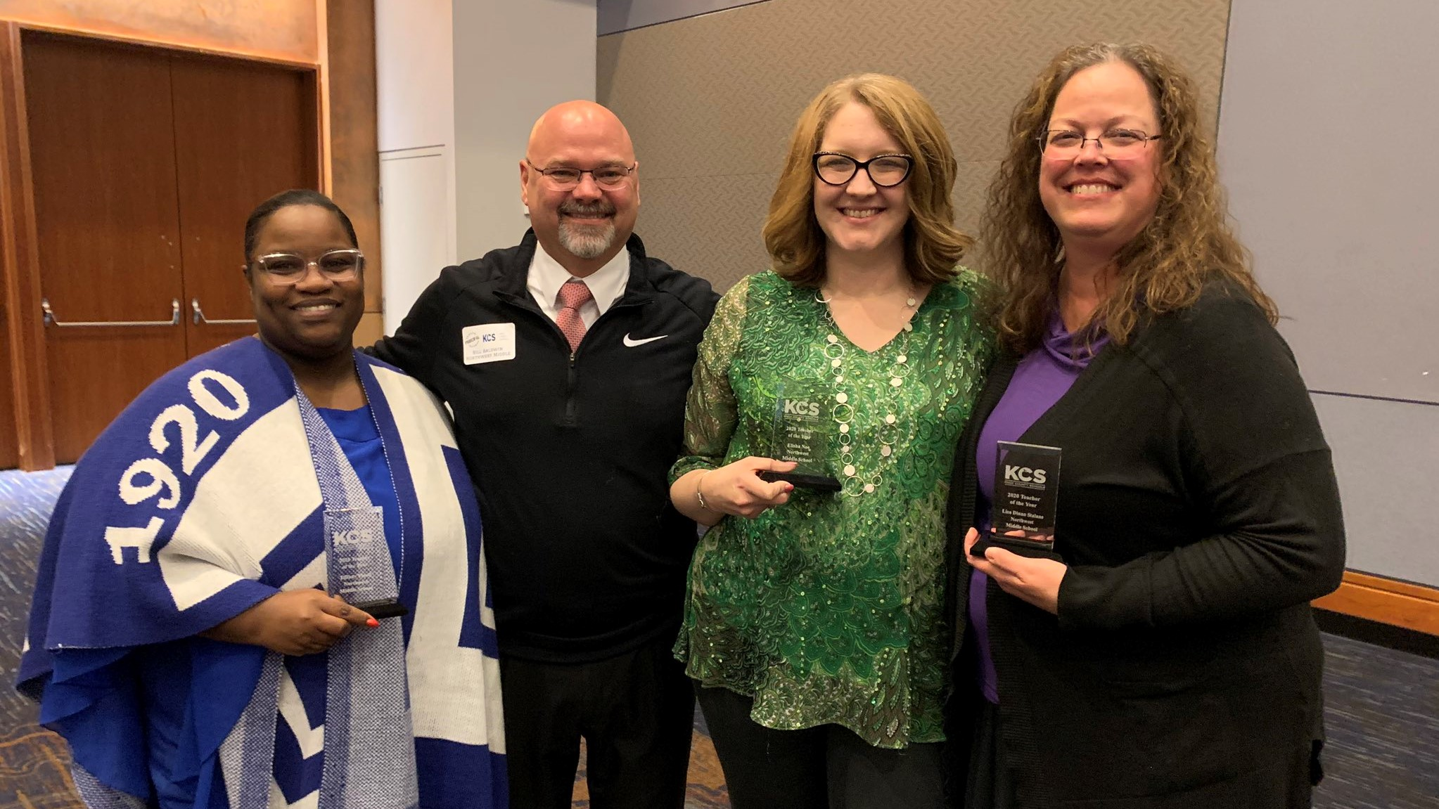 Northwest Middle School principal Bill Baldwin poses with teachers Tiffany Flood, Elisha Noe and Lisa Stalans at the Teacher of the Year banquet on Feb. 18, 2020.
