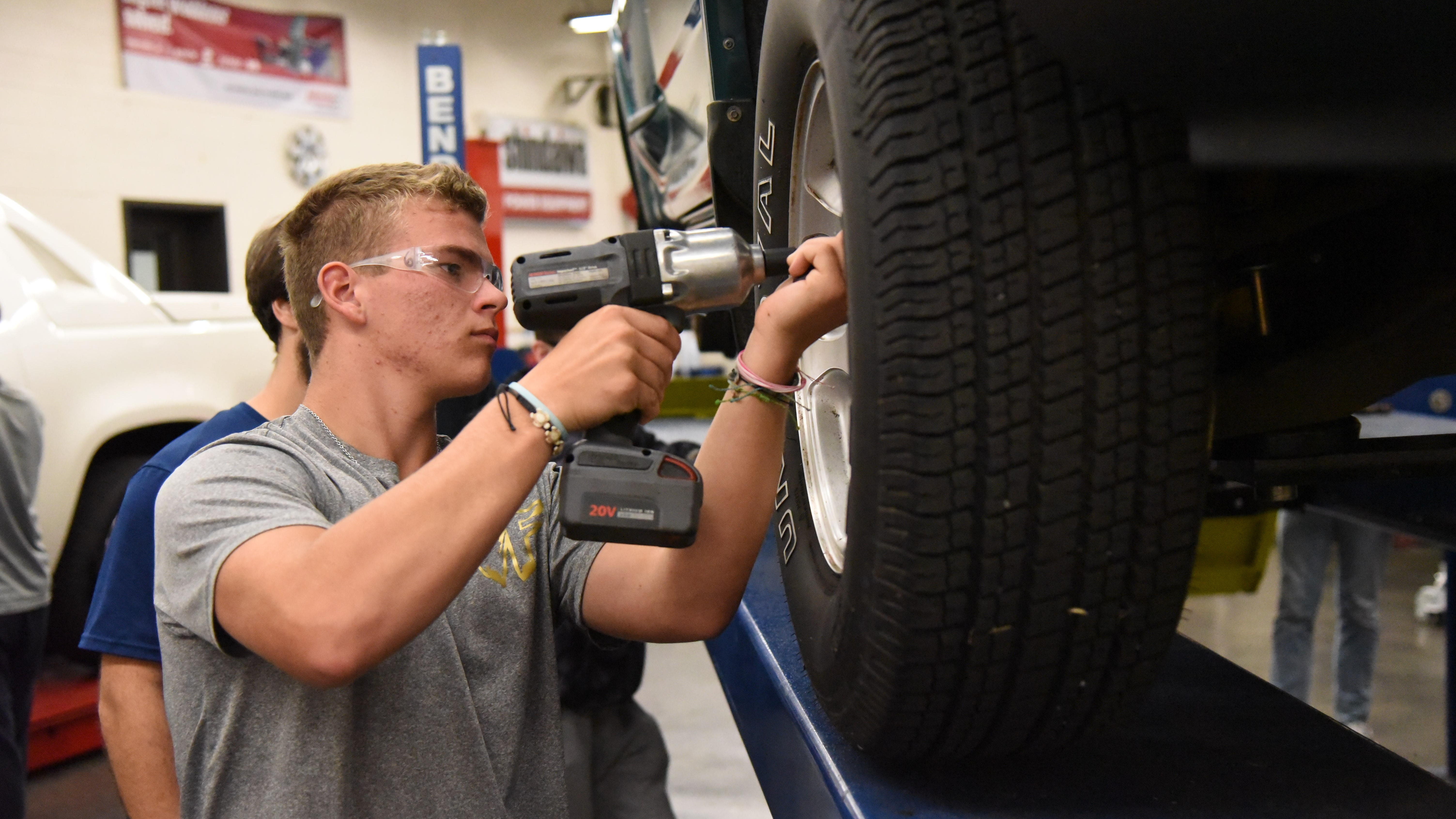 Bryson Harvey, a senior at Gibbs High School, works on a vehicle during a CTE class on Oct. 15, 2019.