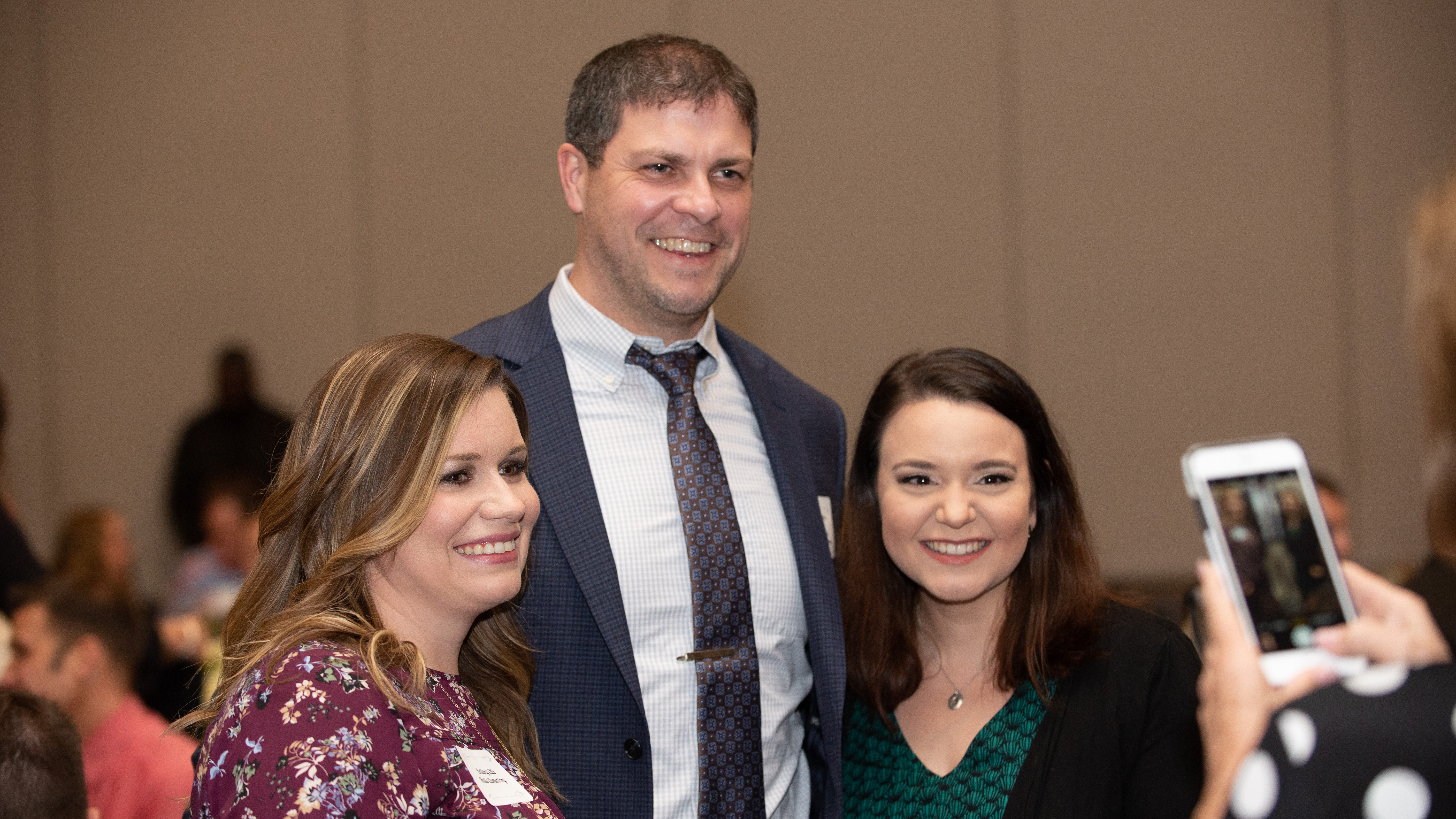 Halls Elementary Principal Mitchell Cox takes a picture with teachers Britany Ellis (left) and Rachel Todd at the KCS Teacher Of The Year dinner on Feb. 26, 2019.