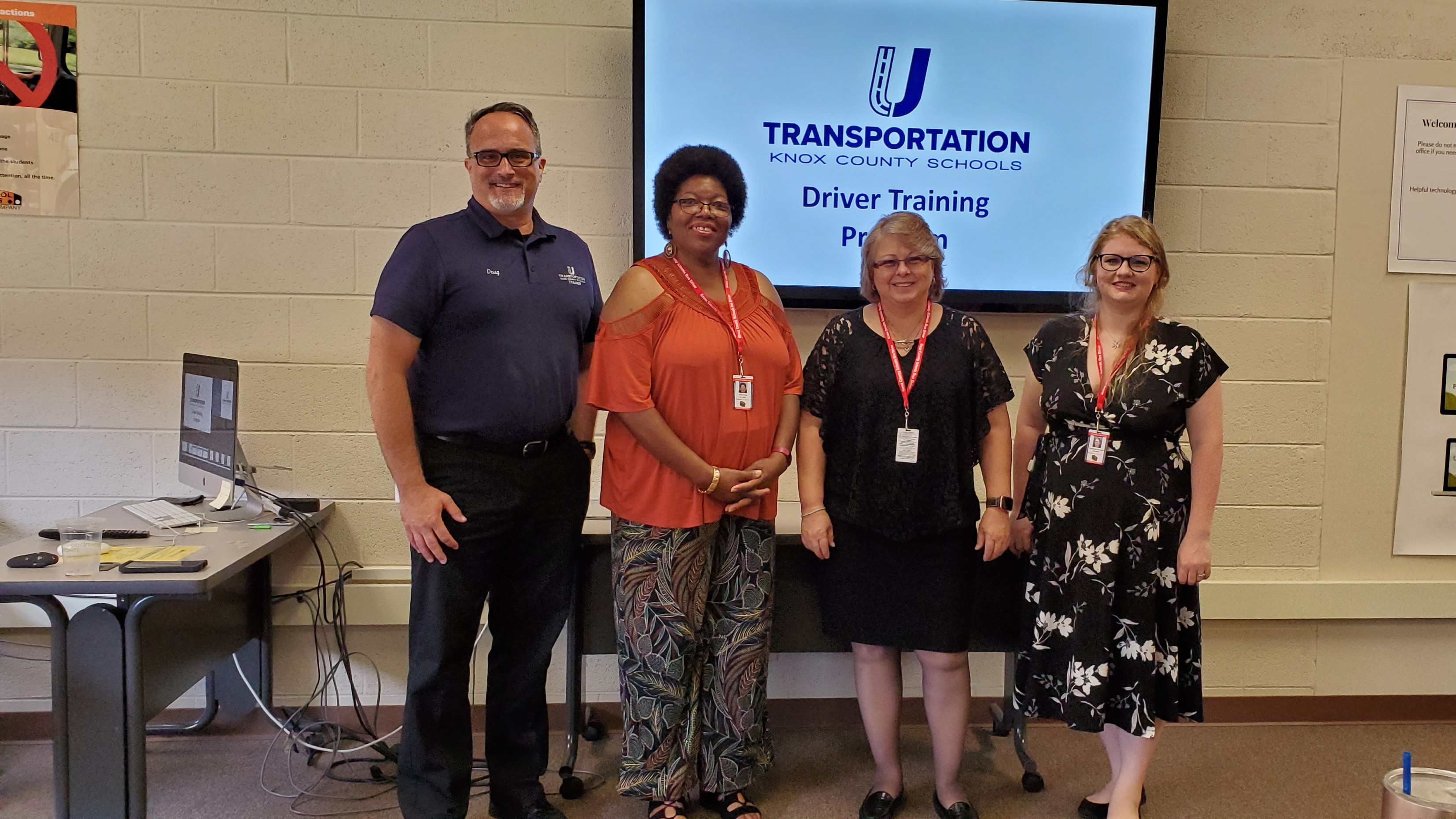 Transportation U, a KCS program that trains new bus drivers for Knox County Schools, recently celebrated its first class of graduates. In this picture, trainer Doug Romig (left) stands with (L to R) Anita King, Bonnie Gillespie and Cheyenne Rickman.