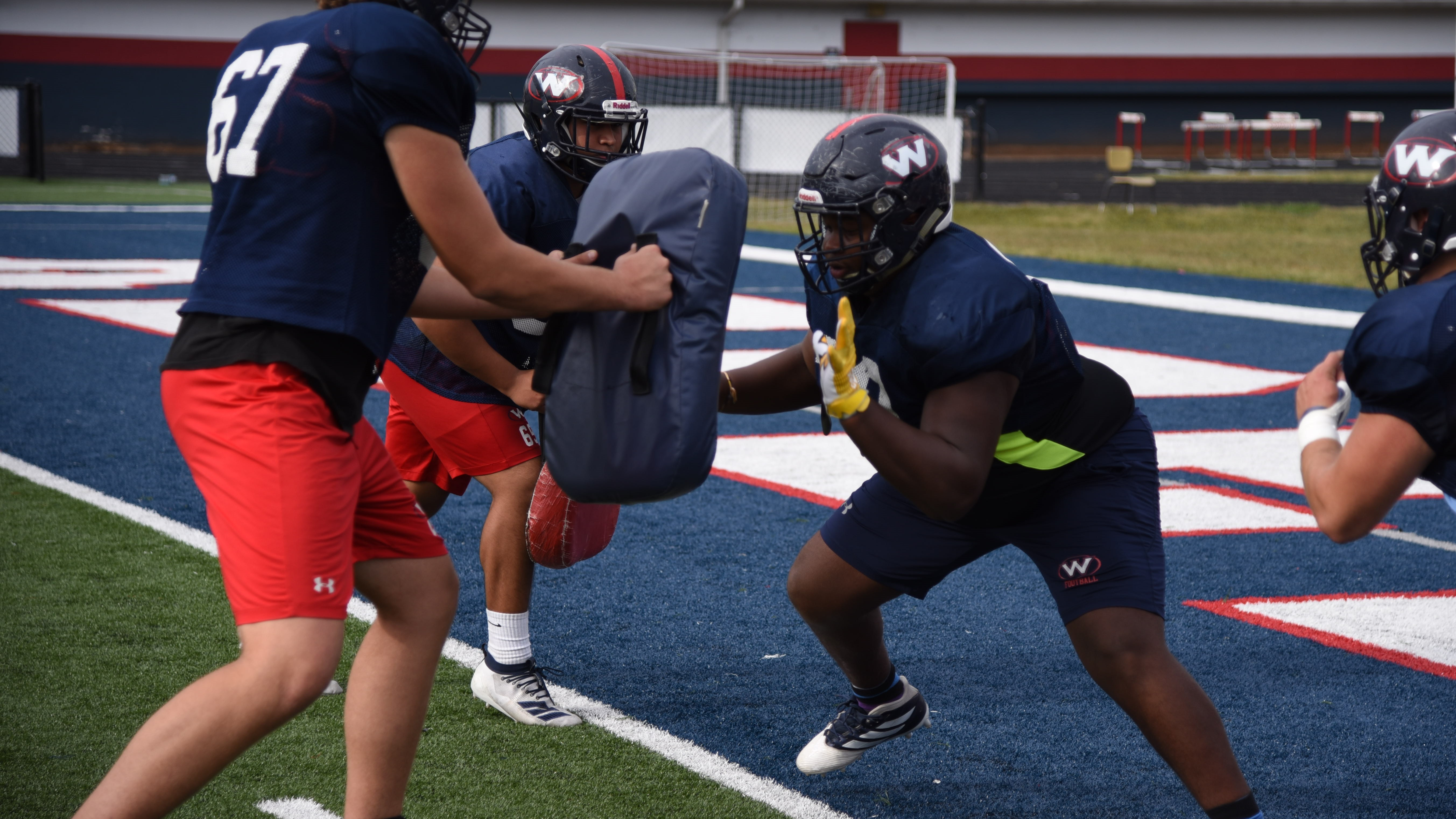 Tyrell Ragland participates in offensive line drills during a practice at West High School on Oct. 15, 2019.