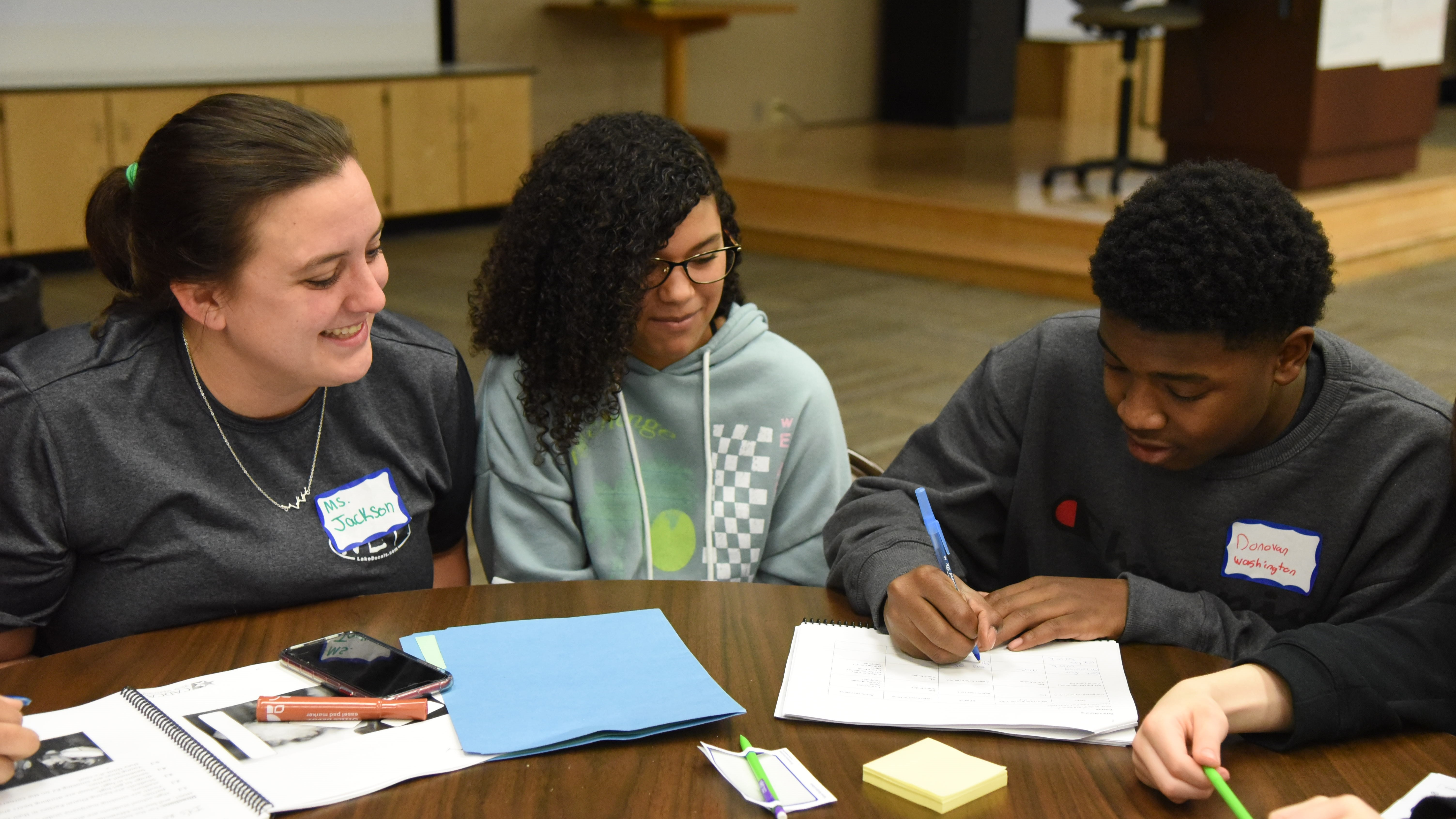 Madelyn Jackson, a guidance counselor at Holston Middle School, works with 7th-grader Savanah Brooks and 8th-grader Donovan Washington during a Vaping Prevention Summit on Jan. 9, 2020.