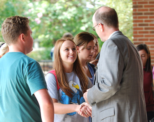 Dr. McIntyre speaks with students
